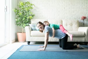 woman-working-out-at-home-with-daughter
